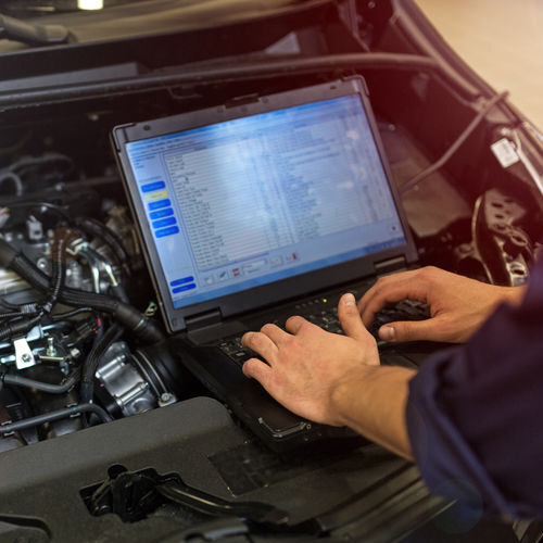 A Mechanic Runs a Diagnostic on an Engine.