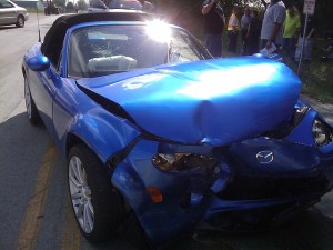 a photo of a crashed blue car