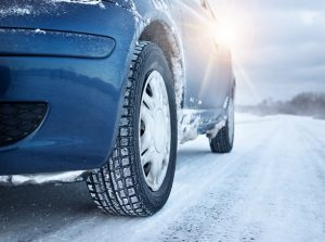 A Car on an Icy Road to Illustrate the Need to Winterize a Car for Bad Weather.