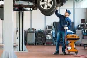 Mechanic changes car fluids